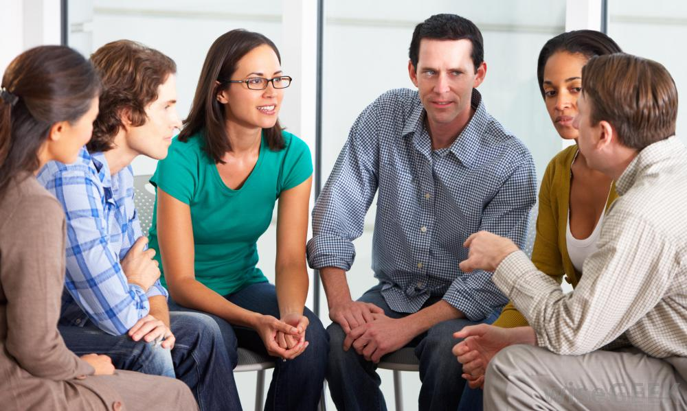 group-of-people-in-therapy-talking